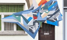 Strook Creates Colorful Street Murals with Recycled Wood