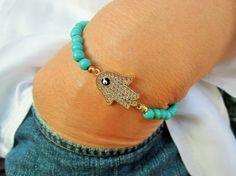Check out this item in my Etsy shop https://www.etsy.com/listing/239937761/hamsa-hand-jewelry-evil-eye-bracelet