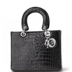 The medium Lady Dior bag in black crocodile embossed leather with light gold hardware