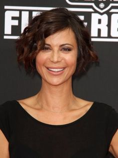 """The best way to add feminine texture to a chin-length bob is by wrapping a few pieces around a ½"""" curling iron. Be sure to leave an inch at the bottom uncurled to achieve Catherine Bell's carefree look. #hairstyles #bob"""