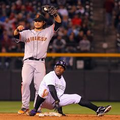 Game 5/162, 4/11/2012; Brandon Crawford tries to stop Erid Young of the Colorado Rockies from stealing second, although the attempt is futile, during the fifth inning.