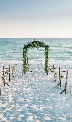 A stunning backdrop for a #beachwedding | Brides.com