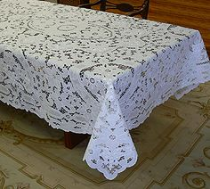 A beautifully crafted traditional all over cutwork tablecloth with grape embroidery