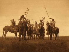 Atsina Warriors, 1907 by  Edward Curtis