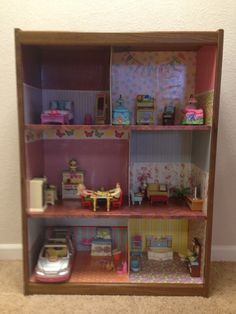 High Quality I Took An Old Book Shelf, Covered It With Scrapbook Paper And Mod Podge And  Filled With Fisher Price Dollhouse Furniture. Much Bigger Than The One They  Sell ...