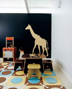 there is a giraffe in the playroom!