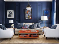 Navy walls with oatmeal and white furniture make for a comfy chic living room by Serena & Lily!