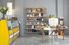 article-image Located in the newly gentrified Woodstock neighborhood of Cape Town, Superette is a cafe and retail outpost opened by Justin Rhodes and Cameron Munro, the entrepreneurial duo behind the nearby Neighbourgoods Market. Interior Desing, Gray Interior, Cafe Restaurant, Restaurant Design, Deli Cafe, Restaurant Interiors, Vintage Fridge, Sweet Home, Cafe Style