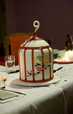 """note for later: I'm pinning this because I like the fondant """"leather"""" strapping. faux-faux bois? icing that looks like leather that looks like a birdcage? Anyway. just a nice technique."""