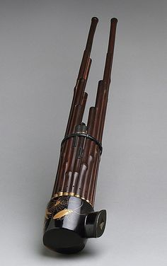 Sho Period: Early Tokugawa period Date: 19th century Geography: Japan Medium: Bamboo, wood, metal Dimensions: L. longest pipe 45.4 cm (17-7/8 in.); L. shortest pipe 18.1 cm (7-1/8 in.) Classification: Aerophone-Free Reed