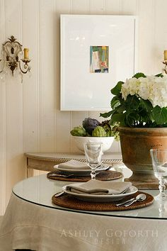 used rattan round chargers and the artichokes again with floral pot centerpiece. Using table cloth can stage with more basic table underneath and dress up formal dining room
