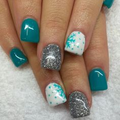 Aqua blue nails with snowflakes and silver glitter. Instagram: @boop711