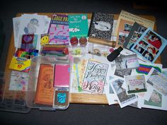 """My """"Distress Tolerance"""" box...lots of things to distract. From a journal to pics to momentos to tea to markers and doodle pages. Even a kaleidoscope and a flashy pink light for the nights I can't sleep. What will yours hold??"""