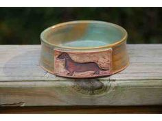 Beautiful handmade dog bowl made by one of Little Paws Dachshund Rescue foster parent who is a professional potter. Approximately 5 inches in diameter and each one has slight variations as they are individually made.