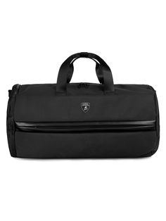 The Automobili-Lamborghini travel bag is a practical and functional accessory made from a hi-tech material. It has been elevated with a zip pull that references the iconic hexagonal detail on the super-sports cars made by the legendary manufacturer at Sant'Agata Bolognese.