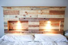 A cool headboard made from recycled pallets and with integrated lights!