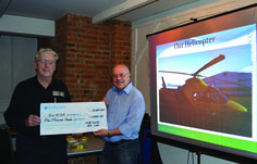 At the May 2015 meeting of the North Leicester MG Club (NLMGC), an interesting, fact-filled talk and video presentation was given to a packed club room at the Anchor Inn, Hathern, by DLRAA (DERBYSHIRE, LEICESTERSHIRE AND RUTLAND AIR AMBULANCE) volunteer fundraiser Tony Bradley.  Afterwards, NLMGC chairman, Colin Readwin, presented a cheque for £1,000 to Tony, to assist the local air ambulance service in their vital work.  The Bradgate Magazine