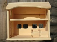 Wooden toy barn with moving stall doors for the animals made by FinnsandFlowers on etsy