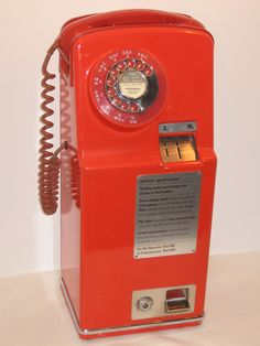Two-slot dial pay phone. Red: quantity 1 Circa 1960. England. - Grant's Telephone Classics