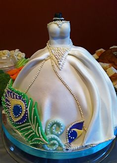 amazing dress cake accented with a peacock leaf