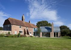 Hawthbush farm extension with a barrel-vaulted roof, High Weald area of the Sussex Downs, England by   Mole Architects