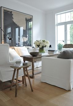 white slipcovers/ rustic wood/ art
