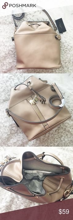 Bucket Bag Beige Great bucket back with large hardware and tassel. NWT. 12 inches in height, approximately 12 inches across. Perfect for traveling. It has a large space inside with  two side pockets on one side. Zara Bags Crossbody Bags