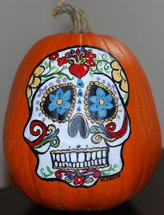 my el dia de los muertos pumpkin I painted last year :)