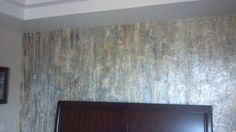 """This is not the greatest picture (taken from my old phone), but it shows a directional pattern from Stoney Brook called Monte Carlo that looks like birch tree bark.  Wonderful and able to be ordered in 54"""" wide stock.  We tore the edges and overlapped, unlike having to bust seams on traditional 54"""" vinyl.  Love it over the Monterrey drag texture."""