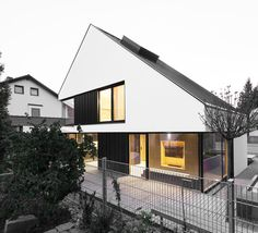 Built by Format Elf Architekten in Aubing, Germany with date 2015. Images by Cordula De Bloeme. Located in the urban outskirts of Munich, the detached single-family house B built in timber frame construction was c...