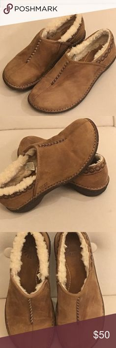 UGG slip on shoes 💚💚In need of that last or next to last gift? These trendy UGGS are just the thing! These Ugh Betty's are practically Brand New!! Worn Twice!! Light tan leather outside with shearling to keep your tootsies warm on the inside! Great Deal!!  💥🎉 UGG Shoes Flats & Loafers