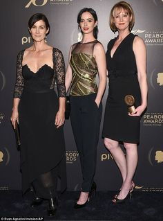 Dream team: Krysten was joined at the event by co-star Carrie-Anne Moss (L) and showrunner...