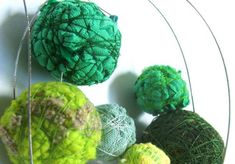 many hued green balls of whimsy!  this recycled textile jewelry is very interesting!