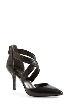 Gorgeous black embossed cross strap pointy toe pump for fall.