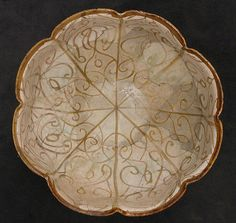 Bowl Date: 12th–13th century Geography: Iran, Rayy Culture: Islamic Medium: Stonepaste; luster-painted