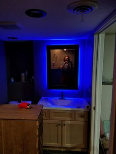 Learn how to make a glowing backlit mirror. Easy DIY project that will take 1 hour. Full details at LeahandJoe.com