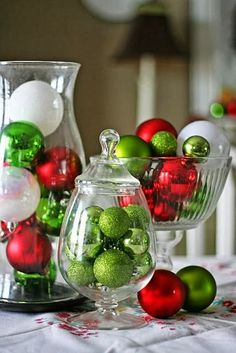 Christmas Centerpiece ◆ Fill your favorite glass containers with ornaments of your favorite holiday season colors, set out on table in group of 3 's and Enjoy!