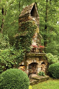 Photo Credit: Emily Followill. A stone fireplace is part of the side garden.—<em>Highlands, North Carolina</em>