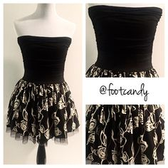 """Black & Cream Date Night Dress Sexy black tube top dress with figure accentuating elastic waistband, black/ivory floral skirt design, and feminine mesh/lace detail at the bottom. Upper: 97% rayon, 3% spandex. Skirt: 100% polyester. Super hot!! Length: 24"""".  CLOSET RULES: No Trades. No PayPal. No Holds. No Lowballers! (PR001) Dresses"""