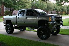 Lifted Silver GMC Sierra truck nice wheels