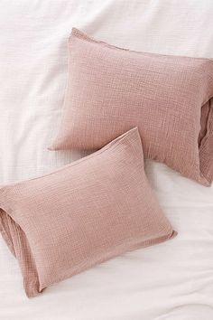 "Set of 2 gauzy pillow shams for a light + airy update to any bedding! Pairs perfectly with our Crinkle Gauze Duvet Cover (sold separately).    Content + Care  - Set of 2  - Cotton  - Machine wash  - Imported    Size  - Dimensions: 20""l x 30""w"