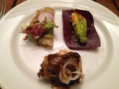 Casa Oaxaca: gordita of duck carnitas, ricotta-stuffed squash blossom, hierba Santa taquito with chapulin sauce