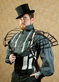 Corset, shoulder cage, and dress shirt by the House of Canney  Shirt and corset available at https://www.etsy.com/shop/TheHouseofCanney Steampunky shoulderpads!