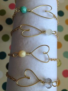 Gold Wire heart with turquoise bead by WiredJewelrybyJenna on Etsy, $10.00