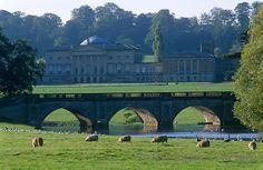 A view of the north front and entrance of Kedleston Hall from across the bridge (Kedleston Hall is an English country house in Kedleston, Derbyshire, approximately four miles north-west of Derby