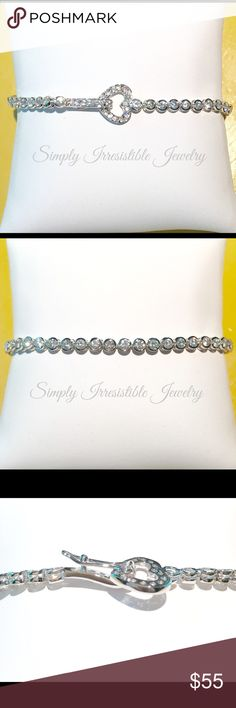 """LAST ONE  Heart Tennis Bracelet AAA CZ bracelet that has sparkle galore!  Clasp through the heart.  Platinum plated -non tarnishing!  Fits up to 7.25"""" wrist.    MSRP $90 Unique!  Simply Irresistible Jewelry Jewelry Bracelets"""