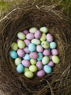 Hard-cooked eggs colored a pale orchid (thanks to a quick dip in lavender dye with a drop of red) look ultra-fresh amongst pea-shoot green and robin's-egg blue companions in this jumbo store-bought nest. #Easter