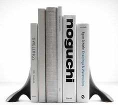 Sleek and modern bookends by Austrian designer Carl Aubock . Photos from the Roadside Scholar . Family Room Decorating, Interior Decorating, Interior Design, Egon Schiele Drawings, Modern Bookends, Supply Room, Informal Dining Rooms, Cool Office Supplies, Design Within Reach
