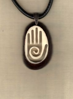 Check out this item in my Etsy shop https://www.etsy.com/listing/109045258/tagua-ivory-pendant-healing-hand