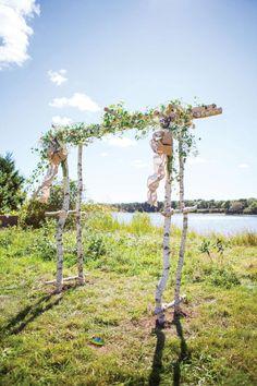 Rustic Chic Celebrations • floral-detailed wedding trellis for an outdoor Martha's Vineyard wedding | Island Weddings